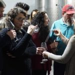 Hector Wine Company's Alex Bond pours barrel samples of wine for attendees of a casual private event