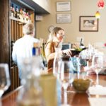 Hector Wine Company's Kristen Emerson pours tastings behind the counter