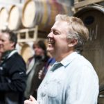 Hector Wine Company head wine maker Justin Boyette smiles during an event in the barrel room