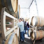 Head wine maker Justin Boyette pulls wine from a barrel at an event