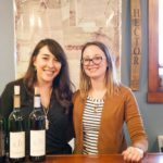 Hector Wine Company's Alex Bond and Kirsten Emerson stand behind the tasting room counter