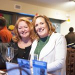 Two women enjoying a tasting room event